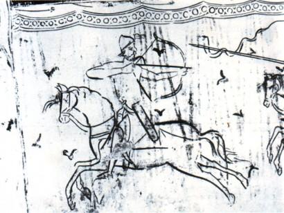 Egy igazi magyar az aquileiai templom faláról: előre lovagol, de hárafelé lövöldöz